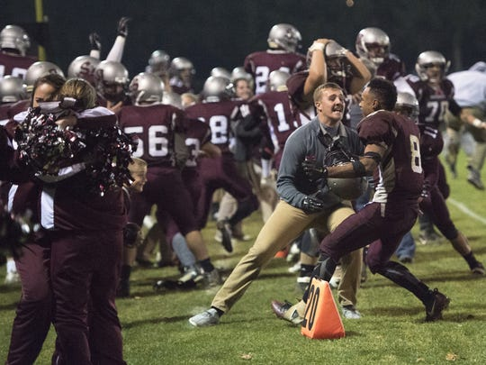 """Shippensburg's football team celebrates with its friends and family after winning a District 3 Class 4A semifinal versus Bishop McDevitt. Scott Smith called his 50th year of broadcasting Shippensburg sports """"very magical."""""""