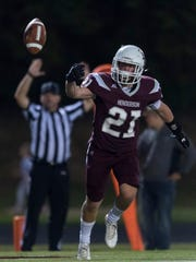 Henderson County's Shane Welshans (21) lets go of the