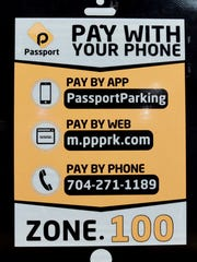What the new signs will be for the paying for parking