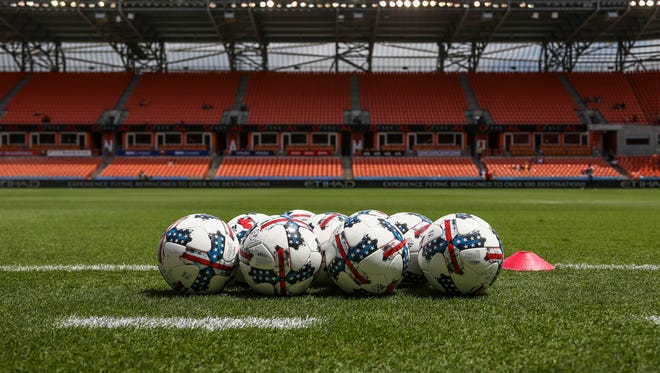 General view of soccer balls on the field before a game between the Houston Dynamo and the San Jose Earthquakes at BBVA Compass Stadium.