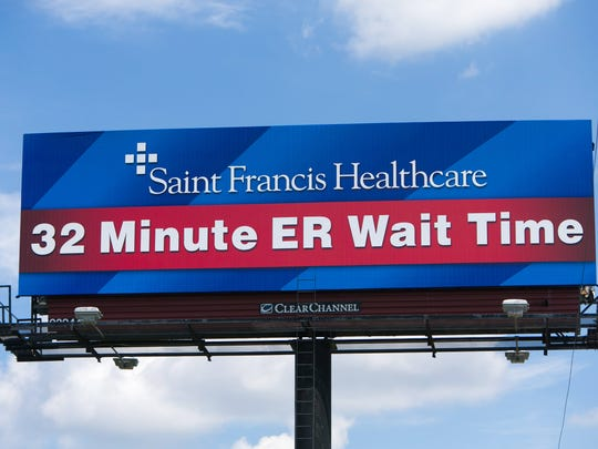A billboard along northbound I-95 near exit 6 in Wilmington of Saint Francis Healthcare promoting their 32 minute ER wait time.