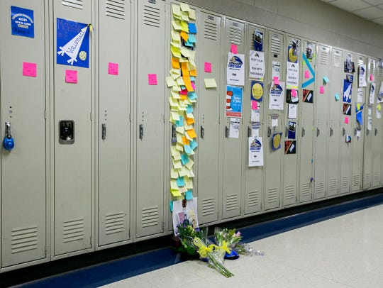 In this March 5, 2018, photo, the locker of Christopher Ruckman is covered with notes from students and faculty at Rockford Christian School in Rockford, Ill.