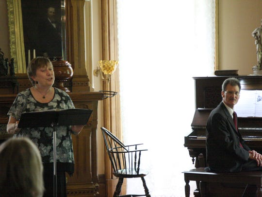"Joan Eckermann sings soprano and Dennis Pita accompanies her on the piano in Sunday's ""Music in the Parlor"" program at the Rutherford B. Hayes home."