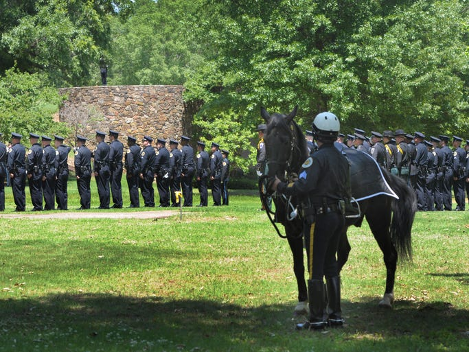 Police officers gathered from all over the state to honor Officer Michael Petrina, who died last Saturday. The funeral and burial took place Thursday May 15, 2014, in Germantown, Tenn.