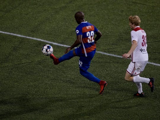 FC Cincinnati defender Justin Hoyte (32) kicks the