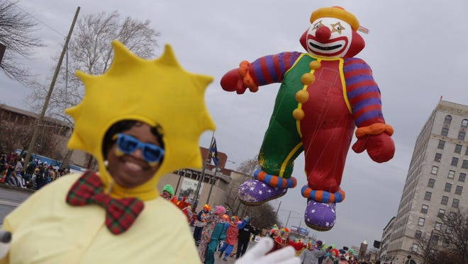 A clown balloon floats down Woodward Avenue at the America's Thanksgiving Parade on Nov. 26, 2015.
