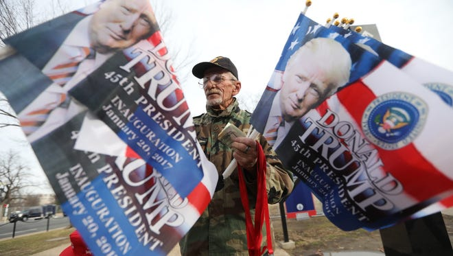 George Davis came to Washington D.C. from Oklahoma to sell Trump souvenirs on the day prior to the inauguration.  Davis, 67, is a veteran who said the proceeds of his sales will go to Vietnam veterans war memorial in Muskogee.