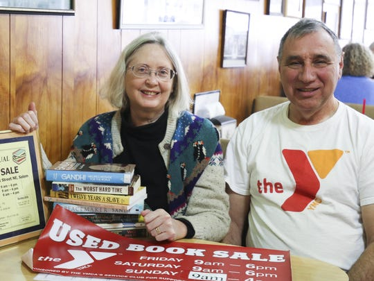 Carolyn Stock and Fred Patron were excited to share news about this weekend's big annual book sale at the YMCA.