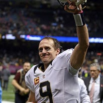 New Orleans quarterback Drew Brees (9) walks from the field after the Saints defeated the Dallas Cowboys in overtime, 26-20, at Mercedes-Benz Superdome in New Orleans on Sunday.