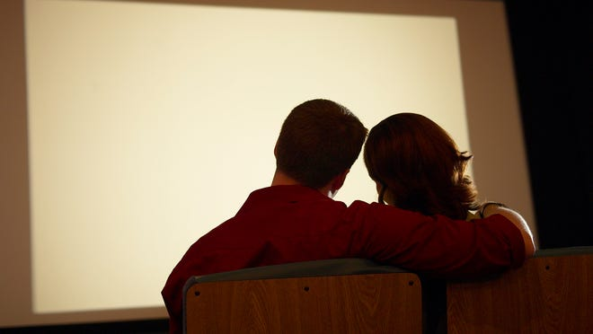 Couple in a movie theater