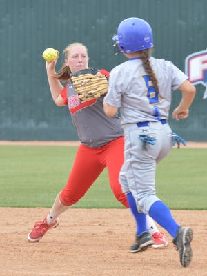 Hermleigh shortstop Lillyan Digby pivots to throw to first while Dodd City's Anna Flaherty tries to reach second base in the fourth inning of Friday's game in Belton.