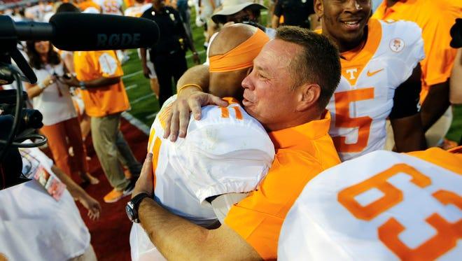 Tennessee coach  Butch Jones hugs quarterback Joshua Dobbs (11), who threw the last-second winning TD pass to beat Georgia 34-31 on Oct. 1, 2016.