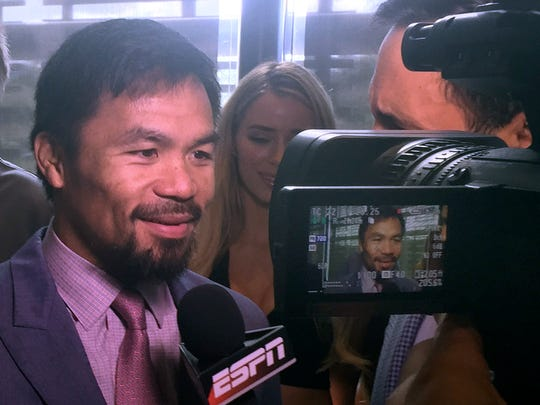 Famed boxer Manny Pacquiao of the Philippines is interviewed following a press conference with Jeff Horn of Australia in Brisbane, Wednesday, June 28, 2017. Pacquiao, is putting his WBO belt on the line Sunday, July 2, against the 29-year-old Horn. (AP Photo/John Pye)