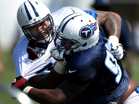 Titans nose tackle Austin Johnson (94) tries to get