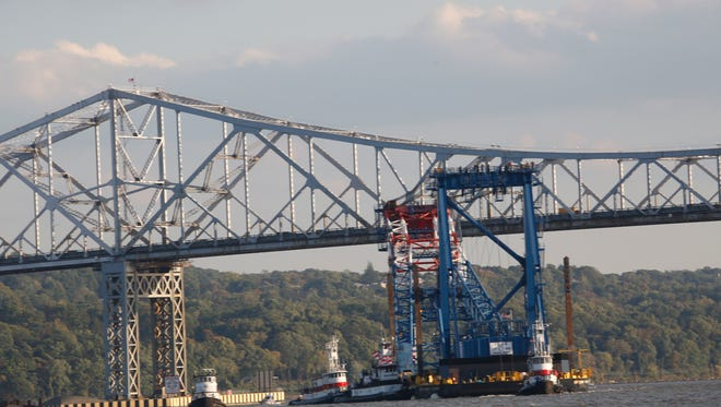 The Left Coast Lifter limbos under the Tappan Zee Bridge to a working position at the construction site of the new bridge on Oct. 8.