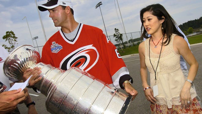 Former St. Cloud State hockey player Bret Hedican and his wife, U.S. Olympic figure skater Kristi Yamaguchi, greet fans while bringing the Stanley Cup into the National Hockey Center in 2006.