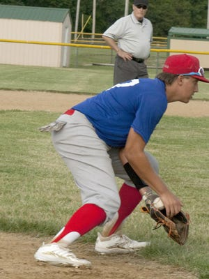Ottawa third baseman Cole Swanson corrals a sharp hit grounder and records the out at first base in the opener Thursday against Newton. [PHOTO BY GREG MAST/THE OTTAWA HERALD].