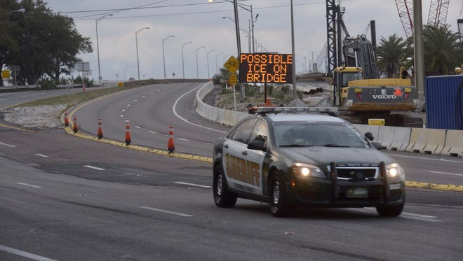 Law enforcement patrols conditions on Pensacola Bay Bridge.