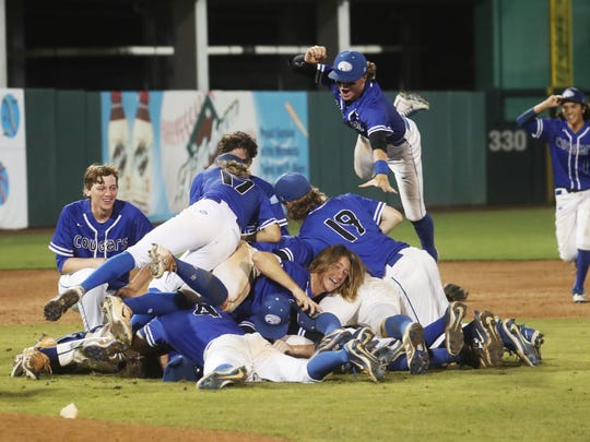 The Canterbury baseball team celebrates a state championship win over North Florida Christian.