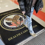 A visitor leaves the Sacramento Veterans Affairs Medical Center in Rancho Cordova, Calif. A new program that was supposed to get patients off waiting lists at VA medical centers by letting them switch to private-sector doctors is proving a huge disappointment.