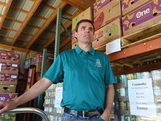 Jeff Quick, executive director of the Food Bank of North Central Arkansas, talks Wednesday about food insecurity in Arkansas. The FBNCA is hosting the fifth annual Bridge Bash on Saturday in Cotter to raise money for hunger relief.