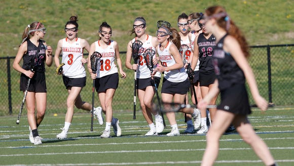 Mamaroneck celebrates during 15-9 win over  Scarsdale