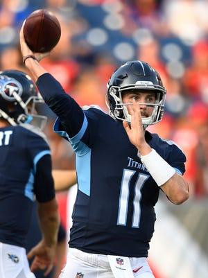 Titans quarterback Luke Falk (11) warms up before the start of the preseason game against the Tampa Bay Buccaneers at Nissan Stadium Saturday, Aug. 18, 2018, in Nashville, Tenn.