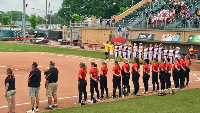 North Union, foreground, and Warren Champion line up for the national anthem before Friday's Division III state softball semifinal in Akron's Firestone Stadium.