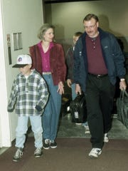 Doug Puza walks to his gate at GreenvilleÐSpartanburg International Airport with his wife Diane, and sons Dallas, left, and Derek, on April 9, 1997.
