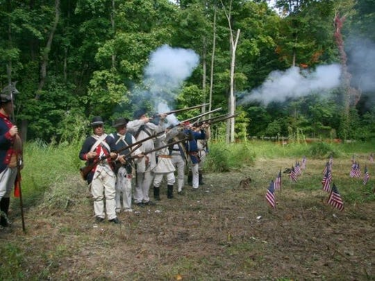 Musket fires to salute fallen soldiers buried in Fishkill.jpg
