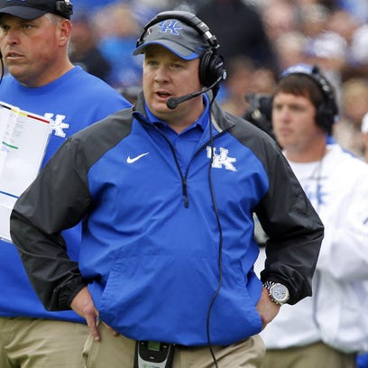 Mark Stoops of the Kentucky Wildcats reacts to his