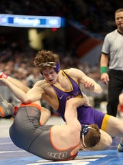UNI's Taylor Lujan wrestles Virginia's Will Schany at 174 pounds at the NCAA Wrestling Championships at Quicken Loans Arena in Cleveland, Ohio on Thursday, March 15, 2018. Lujan won by decision, 5-3.
