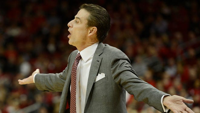 Louisville Cardinals head coach Rick Pitino reacts during the first half against the Clemson Tigers at KFC Yum! Center.