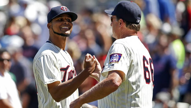 Minnesota Twins starting pitcher Ervin Santana (54) celebrates with interim pitching coach Eric Rasmussen his 4-0 shutout victory over the Oakland Athletics after the game Wednesday at Target Field in Minneapolis.