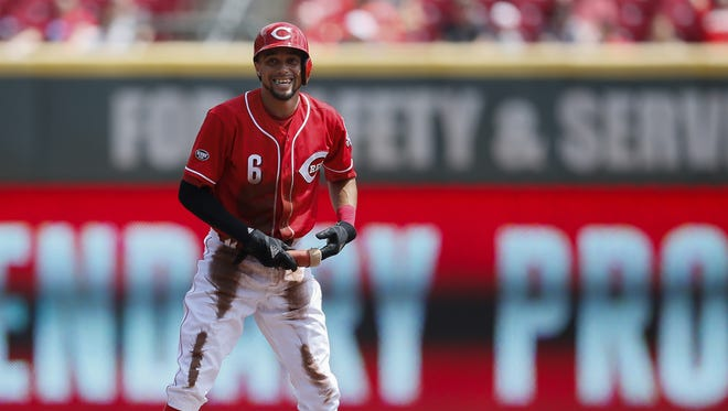 Cincinnati Reds center fielder Billy Hamilton (6) smiles to the dugout after reaching second base on a sacrifice fly in the first inning during the MLB National League game between the Los Angeles Dodgers and the Cincinnati Reds, Monday, Aug. 22, 2016, at Great American Ball Park in Cincinnati.