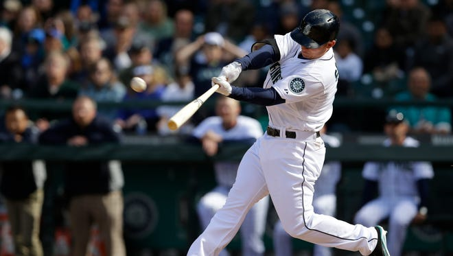 Seattle Mariners' Kyle Seager hits a three-run go-ahead home run in the eighth inning of a baseball game against the Texas Rangers in Seattle.