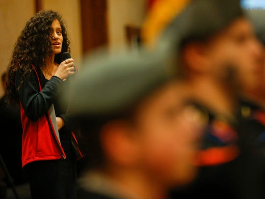 Adayah Glenn, an eighth-grader at Pipkin Middle School, sings the national anthem at the annual United Way of the Ozarks luncheon on Wednesday, April 11, 2018.