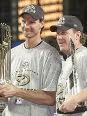 Curt Schilling (right), was twice National League Cy Young runner-up to Arizona teammate Randy Johnson (left), which fueled the pitchers' clubhouse rivalry.