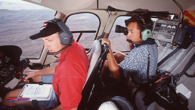 In the air inside of  KTVK Channel 3 helicopter is helicopter pilot Bruce Haffner and photographer Hilton Metzner.