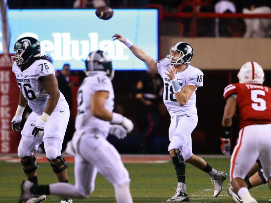 Michigan State quarterback Connor Cook (18) throws against Nebraska in Lincoln, Neb., Nov. 7. The Spartans lost on a controversial play.