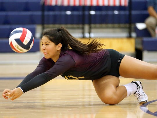 Tuloso-Midway's Erin Perez reaches for the ball against London during the CCISD McDonald's SpikeFest Championship game on Saturday, Aug. 12, 2017, at Veterans Memorial High School in Corpus Christi.