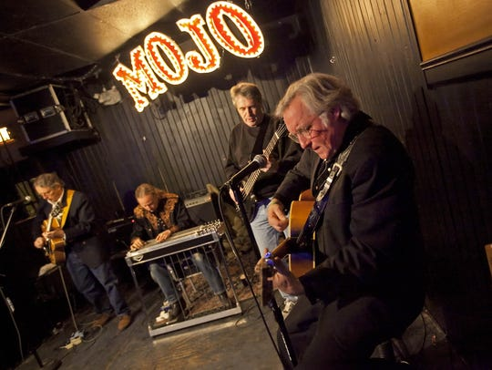 The Sin City Band performs at the former Mojo Main