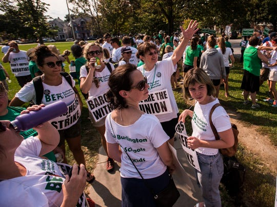 Teachers rally outside Edmunds elementary and middle schools Friday afternoon, Sept. 15, 2017, during the second day of strikes in the Burlington School District.