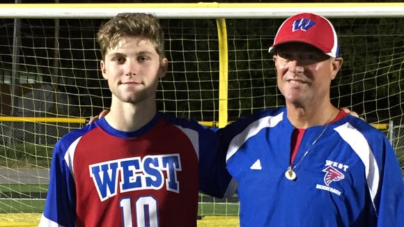 West Henderson senior Tyson Hichman and Falcons coach Brian Brewer.