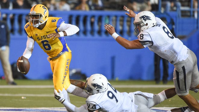 San Jose State quarterback Joe Gray (6) is tackled by Nevada defensive end Lenny Jones (94) during the second quarter at Spartan Stadium.
