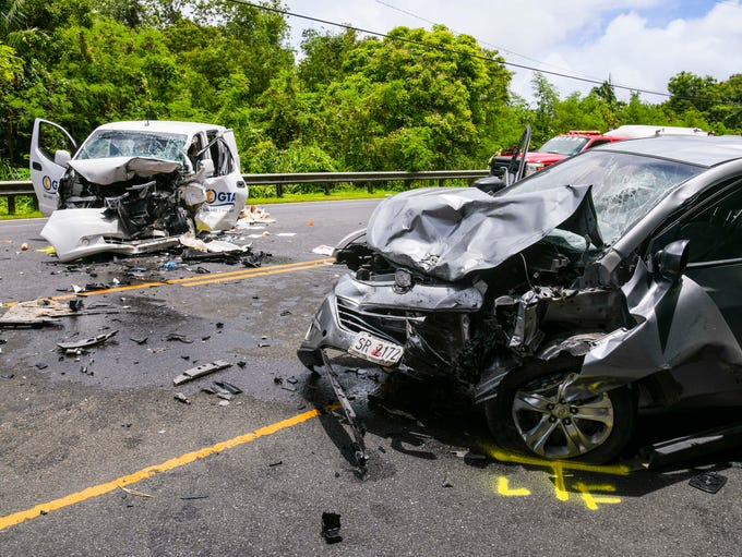 Emergency personnel respond to a fatal auto collision,