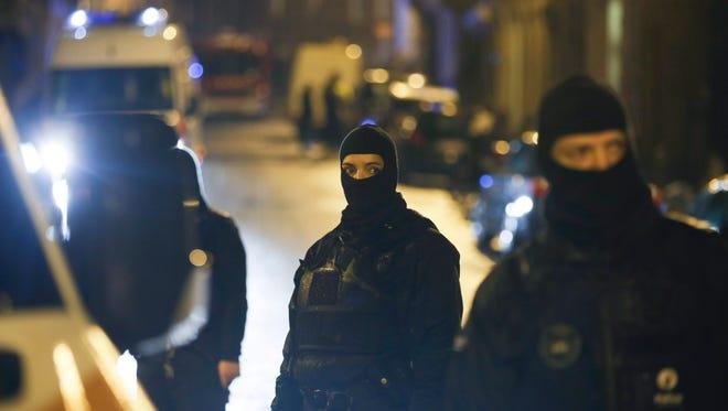 Police block a street in Verviers, Belgium, on Jan. 15 after an anti-terrorist raid.