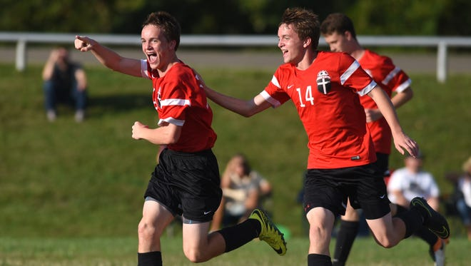 Rosecrans' Weston Nern (18) celebrates with his brother, Paul Nern, after scoring the tying goal during a 3-1 win over John Glenn. They are among seven freshmen playing key roles for the Bishops this season.