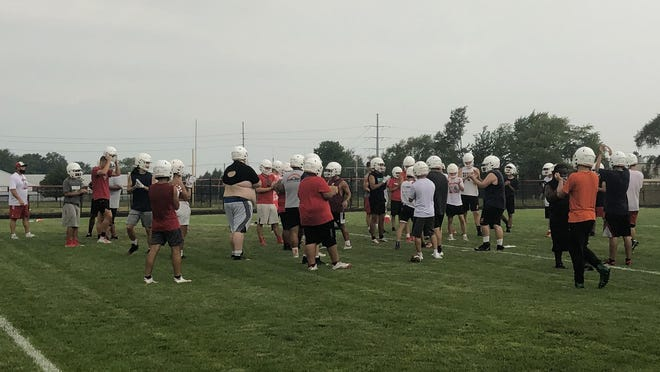 The Holland football team breaks it down after a drill on Monday at Holland.