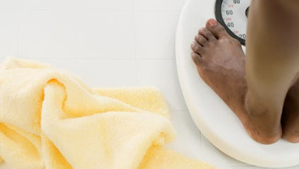 Stepping on a scale once a week can help you stick with a health and fitness regimen.